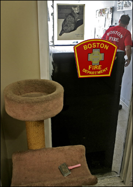 A photo of firehouse cat Maxine hangs at Division I Fire Department Headquarters. Maxine, the diva of firehouse cats, died after a 21-year reign at the station.