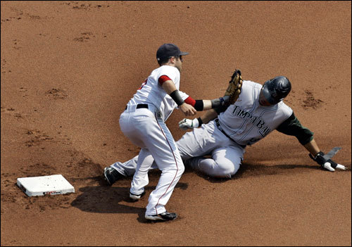Carl Crawford slides in under the tag in the first inning.