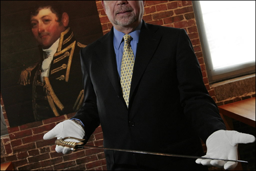 Ronald Egalka, trustee of the USS Constitution Museum, held a sword that once belonged to Captain Isaac Hull that the museum recently acquired. The 200-year-old sword will be in display next to a portrait of Hull. 'It's the closest you can get to the most famous captain of the most famous ship,' Egalka said. 'It's really cool.'