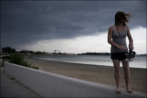 Jennifer Sheehan was hit with a strong gust of wind as dark clouds began looming over Pleasure Bay Monday.