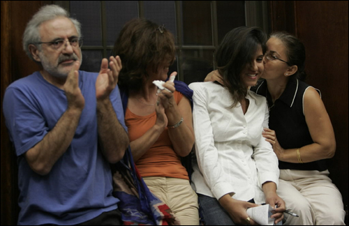 Narini Badalian, 25 (second from right), received a kiss from Gulnar Sahagian after Badalian spoke during a town meeting at Watertown Town Hall in support of the town to rescind the partnership with the 'No Place for Hate' program Tuesday.