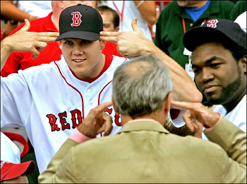 Red Sox pitcher Jonathan Papelbon and Sox owner Larry Lucchino appeared to be mimicking each other as they waited to take a team photo at Fenway Park.