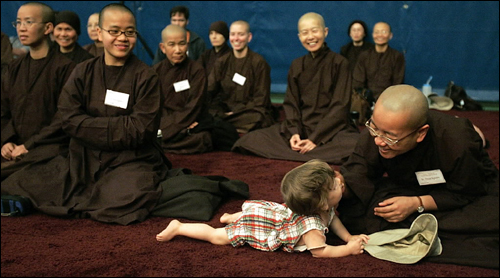 Nine-month-old Finnean Malley, of Columbus, Ohio, escaped from his mother and crawled into a group of Buddhist nuns at a retreat at Stonehill College.