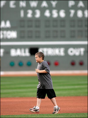 Jimmy Fund patient Jordan Leandre ran the bases after singing the national anthem.