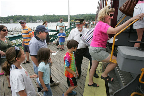 Passengers hop on the Winnipesaukee Scenic Railroad. Conductor Joseph Musumeci oversees boarding.