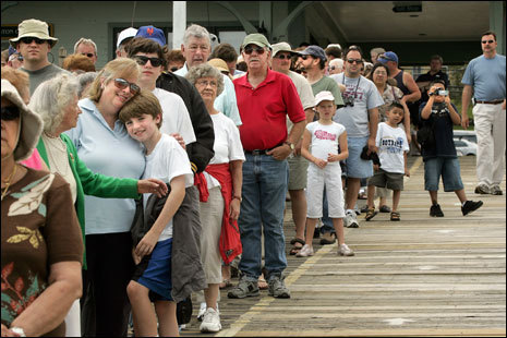 People line up, waiting to board the M/S Mount Washington at Weirs Beach.