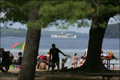 The M/S Mount Washington cruises past Ellacoya State Park on Lake Winnipesaukee.