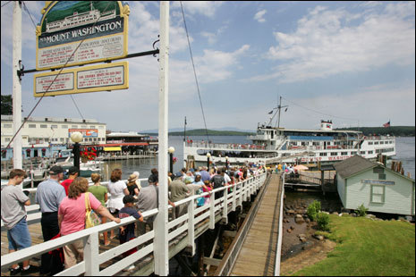 People wait to board the M/S Mount Washington at Weirs Beach on Lake Winnipesaukee.