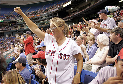 Jennifer Millner of Clermont, Fla., who became engaged to her husband on the field at Fenway Park last year, cheered as the Red Sox scored at Tropicana Field.