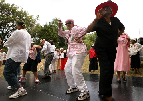 Seniors participated in a dance contest during the 'City Fresh Foods Senior Party in the Park,' on Franklin Park Schoolmaster Hill Friday. Contestants include Joan Porter, 70, center, and Jesula Dubé, 75.