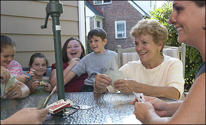 Carmela Marzano playing cards with some of her grandchildren.