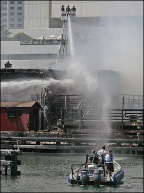 Utilizing a high angle, firefighters sprayed water down on the burning museum.