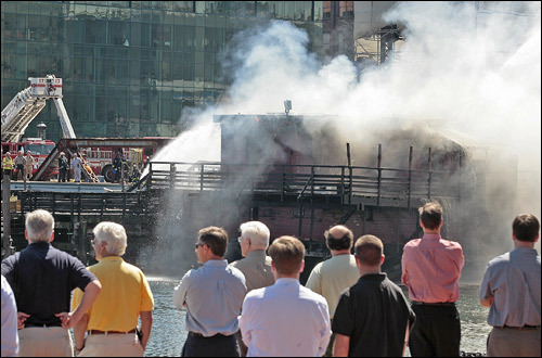 Onlookers crowded the streets to watch the firefighters put out the blaze.