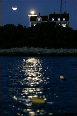 A lunar eclipse was seen during early morning hours over Nobska Lighthouse in Woods Hole, Falmouth, today.