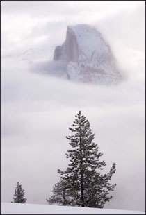 Half Dome, here in a shroud of clouds, formed underground 87 million years ago.