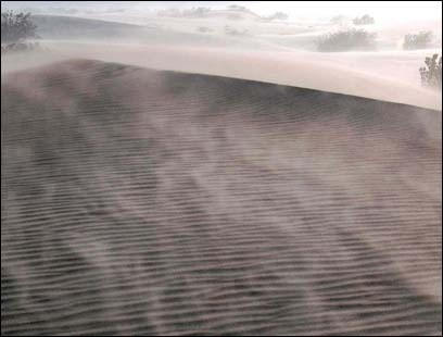 What looks like smoke is actually the wind whipping around desert sand.