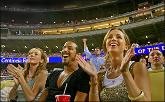Eliza Dushku (R) along with friends, Sarah Mack, and Roman Diez take in a Dodgers/Colorado Rockies game.