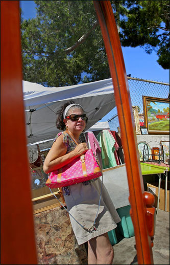 Dushku has been bargain-hunting at the Melrose Trading Post flea market since she moved to Los Angeles from Watertown eight years ago. Dale Fishman of Northridge is a regular at the flea market.
