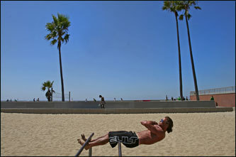 Dushku and Shanahan stopped at Muscle Beach, the seaside workout spot that's been attracting sun-tanned bodybuilder types for decades. Above, Glenn Pennington of New Zealand works out at Muscle Beach along the Venice Beach boardwalk.