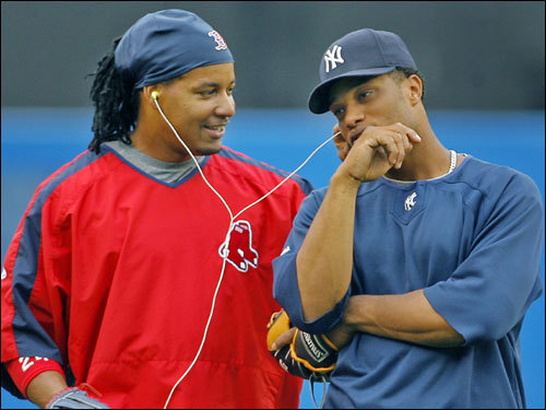 Red Sox left fielder Manny Ramirez (left) talked with Yankees second baseman Robinson Cano (right) prior to the game.