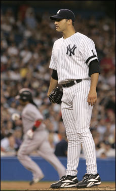 Andy Pettitte (right) looked in to home plate as Manny Ramirez (left) rounded the bases.
