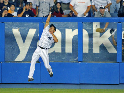 Yankees left fielder Johnny Damon elevated to make the catch against Julio Lugo in the fifth inning.