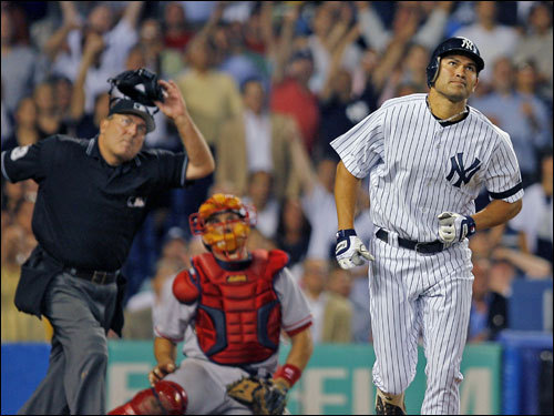 Johnny Damon (right), Jason Varitek (center) and umpire Derryl Cousins (left) all watched Damon's two-run home run leave the yard in the seventh inning.