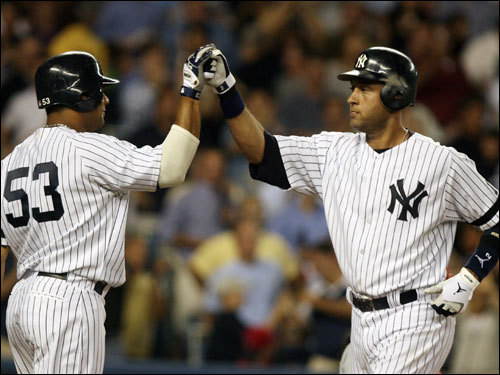 Yankees right fielder Bobby Abreu congratulated Derek Jeter after Jeter's fifth inning home run.