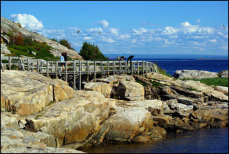 The boardwalk walking trail to Pointe de l'Islet in Tadoussac is one of three walking trails within the village.