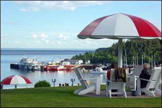 Guests at the Hôtel Tadoussac enjoy a splendid view of the village harbor from their perch on the resort's lawn.