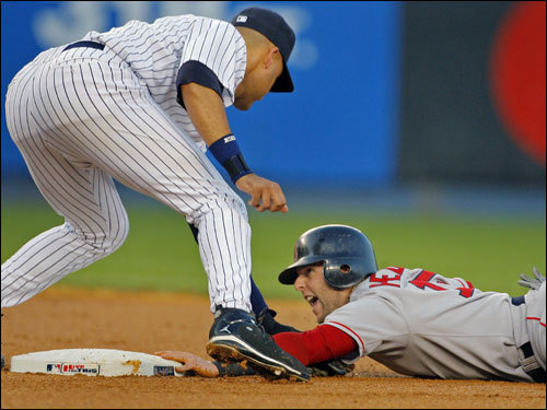 Red Sox second baseman Dustin Pedroia howled as he was tagged out on a steal attempt by Yankee shortstop Derek Jeter.