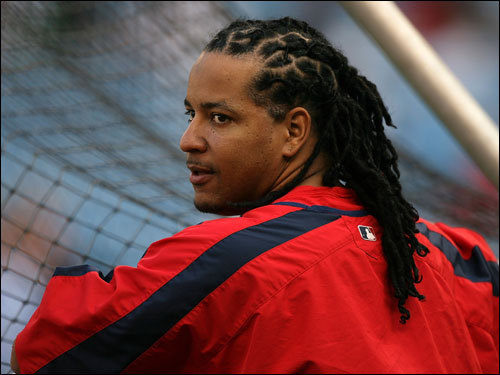 Manny Ramirez, who injured his back and was not in the lineup, watched batting practice before the game.