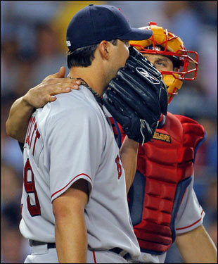 Josh Beckett (left) talked with Red Sox catcher Jason Varitek after struggling in the second inning.