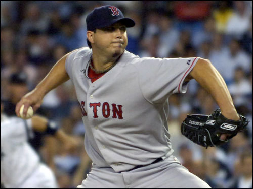 Josh Beckett delivered a pitch in the second inning. Beckett would surrender three runs in the inning.