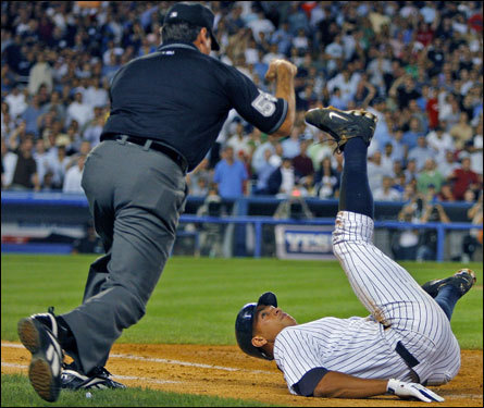 The first base umpire (left) called A-Rod out after he ran over the bag.