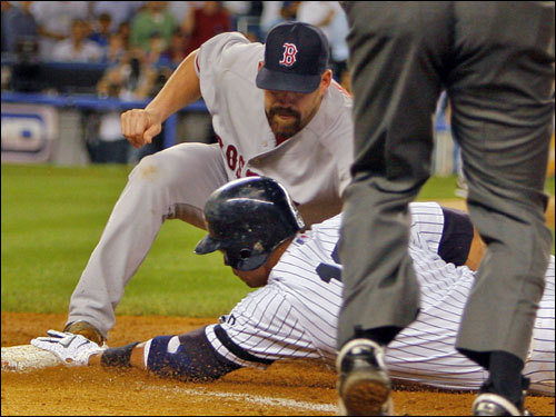 Red Sox first baseman Kevin Youkilis applied the tag.