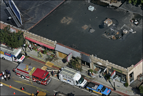 The West Roxbury restaurant where two firefighters died Wednesday in a blaze fueled by built-up grease in the ceiling had a history of code violations for greasy equipment and vents. At left, the restaurant's roof Thursday.