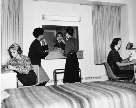 Colleges across the country are scrambling to replace aging and outmoded student housing with high-tech buildings that offer a range of modern amenities. In this Boston University dorm room in 1959, the design was spare but functional, with bare basics including beds, a vanity, and desks.