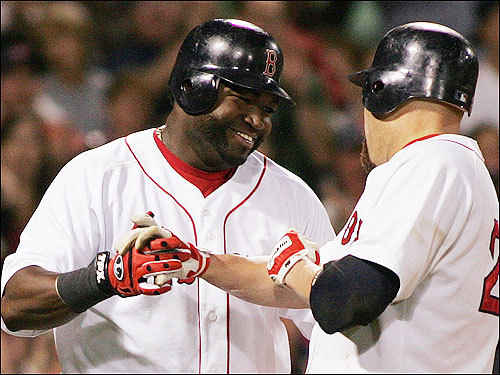 Ortiz, left, smiles as he congratulates Youkilis after Youkilis hit a three-run homer during the sixth.