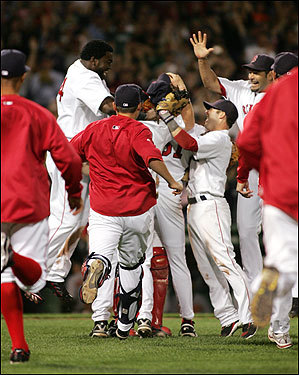 The Red Sox crowd around Buchholz after the last out as they celebrate the team's first no-hitter since Derek Lowe pitched one at Fenway Park on April 27, 2002.