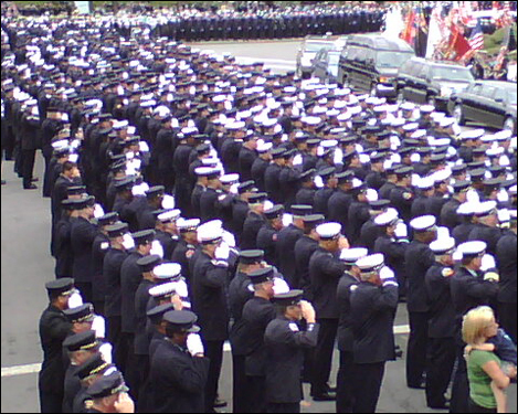 A line of firefighters stretched for 10 blocks from Holy Name Church in West Roxbury before Cahill's funeral today.