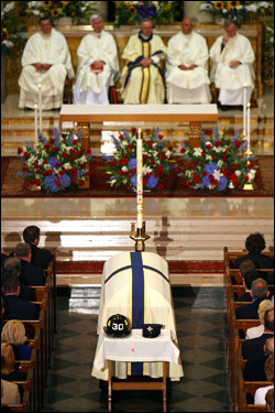 The Rev. Daniel J. Mahoney, chief chaplain of the Boston Fire Department, described Cahill and Payne in his homily as the 'latest heroes in the long blue line.'