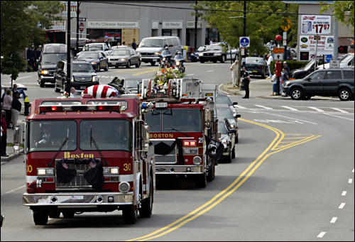 The procession for Cahill began at 9:30 a.m. at Dockray and Thomas Funeral Home in Canton, where he lived before moving to Scituate. At left, the convoy headed down Centre Street.