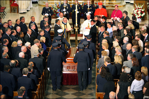 More than 1,500 people filled the red brick Holy Name Church for Cahill's funeral, which included remembrances by his son, Adam, and brother, James.