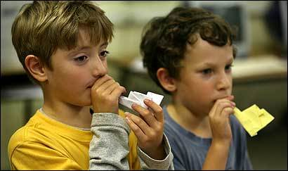 Daniel Seriy (left), 6, and Avi Gold, 7, 'played' the origami shofars they made in preparation for Rosh Hashana at the Rashi School in Newton.