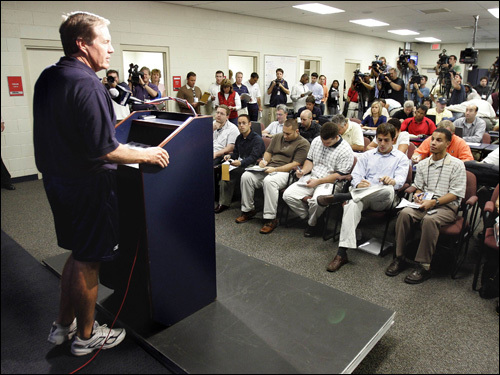 Belichick addresses the media throng.
