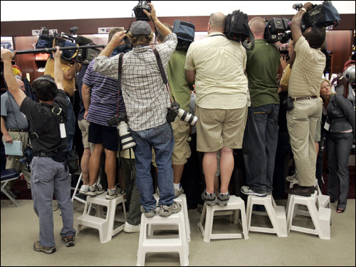 Reporters and photographers jockeyed for position in the locker room.