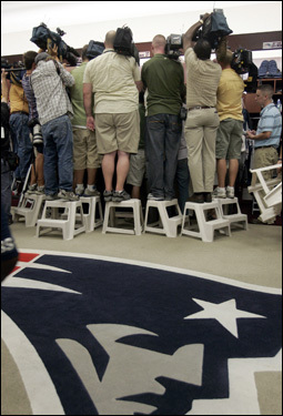 TV cameramen stand on stools to film player reaction.