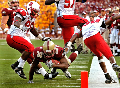 Boston College running back L.V. Whitworth dived for extra yardage, and he just missed scoring a touchdown.