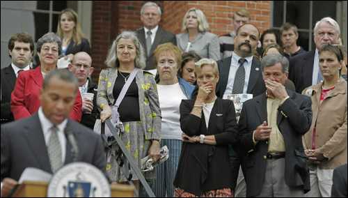 On the sixth anniversary of the 9/11 attacks, Governor Deval Patrick read names of Massachusetts victims on the State House steps, as families stood in the background.